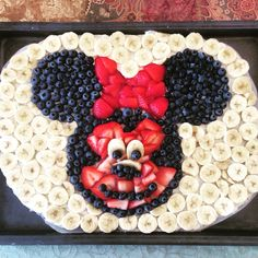 Minnie Mouse fruit pizza. 2 Pillsbury Sugar cookie dough Arrange cookies close together on baking sheet and bake as directed and cool. Mix together 8oz cream cheese, 1 tsp vanilla and 1/3 cup sugar and spread on cooled cookie. Chop strawberries, blueberries and bananas and arrange. It helps to outline shapes, like the head, bow, facial features. I used bowls, mugs for the head and ears. Enjoy!