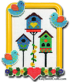 "BIRD HOUSES -- 57BH -- Choices, choices, better than a nest in a tree!  Birds and Flowers stitched on 10-ct plastic canvas decorate a yellow 5""x 7"" Hoop-Frame. Aida cloth 11-ct and all materials are included.  EasyStreetCrafts.com"