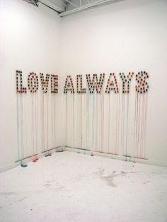 Brooklyn based artist Julia Chiang uses a wide variety of materials in her sculpture and installation based work, including nostalgic and sweet ring pops. The colorful candy has been used by Chiang in a number of works often employed as pixels spelling out words. The candy jewels atop the rings melts over time under gallery lights and slowly drips down the walls.