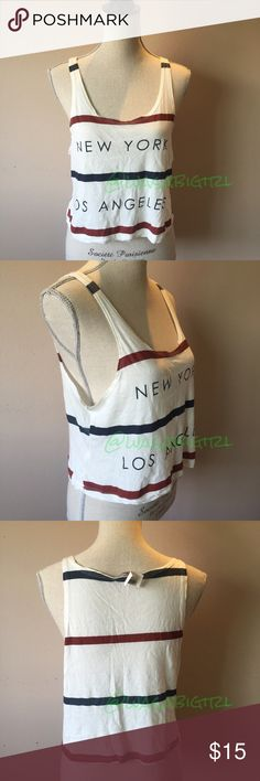 ✨NEWLY ADDED✨ New wTags Brandy Melville NY LA Tank New York Los Angeles  Brandy Melville Tank. Cute with bandeau or lace bralette. Soft 60% Cotton/ 40% Micromodal.  No Trades Brandy Melville Tops Tank Tops