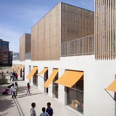 Workshops clad in timber batons sit atop this children's centre outside Paris.