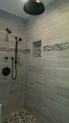 River pebble inlay. Spa shower. Bathroom remodel. Oil rubbed bronze shower fixtutes. Glass shower wall and door. Soap boxes with inlay. River rock floor.
