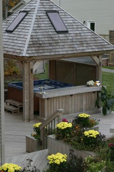An open gazebo defines and protects a deck hot tub. Notice the built in design features including planters and bar. Gazebo, Pergola, Hot Tub Deck, Covered Decks, Outdoor Living, Outdoor Decor, Hot Tubs, In Ground Pools, Nova Scotia