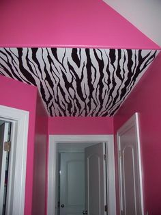 Our bathroom is pink like this with black throw carpets.  I bought the stencils to zebra print a boarder around the top by the ceiling.  Now all I need is the zebra print shower curtain and to paint the cupboard doors black! :) Can't wait til its all done! We are going to have a rockin girls bathroom!