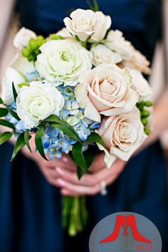 Blush roses and blue hydrangeas in the bridesmaid bouquet really stand off the navy blue bridesmaid dress.