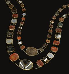 Two gold and hardstone intaglio necklaces,  Circa 1820  The first set with forty three oval intaglios carved with themes and motifs of Classical scenes and mythological subjects, chalcedony, banded agate, carnelian, sardonyx, bloodstone and jasper, length approximately 870mm; the second set with twenty-two variously shaped intaglios of similar inspiration in various varieties of chalcedony, length approximately 600mm, intaglios mostly Neoclassical, some ancient.