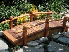 Image from http://www.gardenstructuredesign.com/wp-content/uploads/2011/01/GardenBridgeWithRail1.jpg.