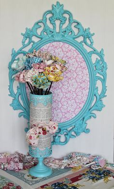 Love this frame ideas with fabric.  Wanting to redo the living room colors...  might have to use this as inspiration