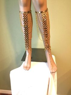 A unique piece of fashion leg chains. Can be used for any occasion: with a formal as well as with a casual outfit; with a swimsuit or with a jeans skirt. This exceptional piece of fashion jewelry is sold as a pair. Made of gold color metal chains and little crystal-clear beads. On the back