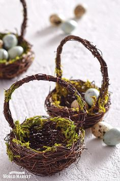 Give your springtime decor a fresh, organic feel with this lush pair of baskets - one round, one square. Crafted of real twigs and adorned with faux moss and ferns, they're eye-catching displayed empty or filled with bright Easter eggs. #WorldMarket Easter Decor