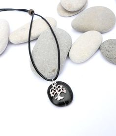 Tree of Life Spanish beach pebble pendant. by EvasBeachStones