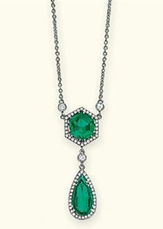 AN EMERALD AND DIAMOND PENDENT NECKLACE The hexagonal-shaped emerald weighing 1.89 carats within a brilliant-cut diamond surround suspending a pear-shaped emerald weighing 1.61 carats from a diamond collet connecting-link, to the fine-link neckchain with diamond detail,