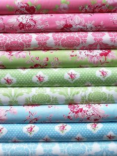 i just love these fabrics.  i need yards and yards of all of them!
