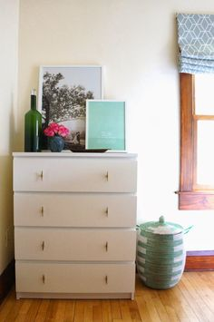 Anthropologie knobs (swoon) give the clean-lined dresser just a hint of personality. While this DIY doesn't require any paint or brushes, it does need the help of a drill to create holes for the handles. See more at Oakland Avenue »   - HouseBeautiful.com