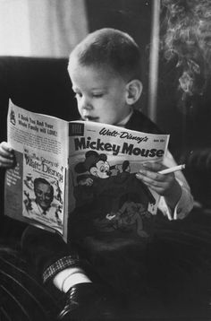 Michael Rougier, A two-year-old smoking and reading. USA, 1959.bg