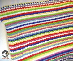 """This pattern is suitable for beginners/intermediate crocheters who know the basics. The total yardage for a large blanket (1 x 1.80 m) is about 3000 m, however its totally up to you how much yarn you want to use! I used 20 colors in total."""