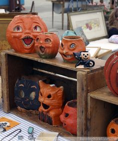 Irresistible antique paper-mâché cats and jack-o'-lanterns at the flea market this Halloween!