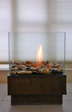 Indoor Fire Pit. I can just see roasting mini marshmallows over this at the dining room table. ^_^