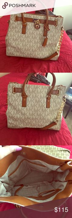 Michael Kors Bag! Love it but gotta let her go! Brown and white (cream) Michael Kors Bag. Condition 8/10. I dont really wear purses so, letting this baby go. No rips nor tears. Just a little wear in one piece of the handle which is pictured above. MICHAEL Michael Kors Bags Shoulder Bags