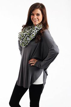 """The Aiden Tunic, Charcoal $32.50  This top is soft and simple! You can never have too many tops like this one. The solid colors makes it easy to pair a scarf or jewelry with it and the length is great no matter if you are short or tall!   Fits true to size. Miranda is wearing the small.   From shoulder to hem:  Small - 31""""  Medium - 32""""  Large - 34"""""""