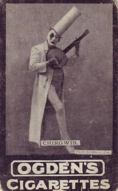A clown in a cigarette costume playing the banjo. What were they thinking when they decided this was the best course of action for their advertisements?
