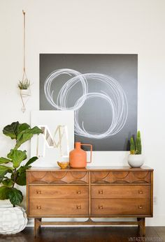 Large art that covers lots o' space. I am a MASSIVE fan of large scale art and it takes the guess work out of what to do with that giant blank wall.