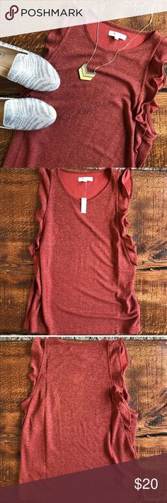Lowest! Madewell Ruffle red metallic shimmer Top Madewell Ruffle red metallic Tank Top size Large. Tagged large, but fits more like a medium. Made of glittery ribbed fabric, this certified party top has pretty cascading ruffles down the sides. Wear this tank with jeans or dress it up with a denim pencil skirt. Fitted. Rayon/nylon. Perfect for the holidays! Madewell Tops Blouses