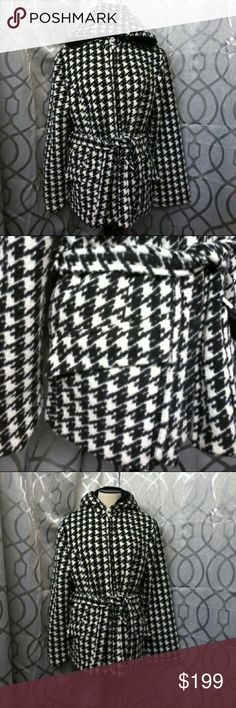 Sandro houndstooth coat size medium Stunning coat in excellent condition by Sandro black and white houndstooth pattern two front pockets full zip hooded and a belt Joann lining 100% polyester measurements laying flat armpit to armpit is 20 inches length from shoulder down 26 inches sleeve length from shoulder down 23 inches Sandro Jackets & Coats