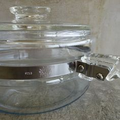 Vintage Pyrex Flameware Saucepan with Lid and pouring spout. Made in USA, 1950s. 1 1/2QT or 1.8Ltrs. Clear Pyrex Glass & Stainless Steel strap.