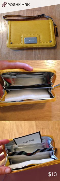Gold Nine West Wristlet Clutch New Silver Wallet This Wristlet is brand new! It has 3 card holders, money slot, and two compartments that could hold a decent sized phone and more! It has a removable Wristlet. In a beautiful gold color with silver hardware. Nine West Bags Clutches & Wristlets