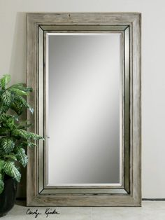"""Mirror has a 1-1/4"""" bevel in a bleached rustic wood frame that features a silver metal champagne rope detail. Contact us to purchase. 45 W X 75 H X 2 D (in)"""