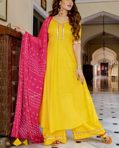 Shop online Yellow kurta set with bandhani dupatta Yellow rayon kurta set adorned with gota detailing, the set comes with the contrast pink bandhej chiffon gota dupatta Pink Kurti, Yellow Kurti, Yellow Dress, Yellow Punjabi Suit, Pink Dress, Dress Indian Style, Indian Dresses, Indian Outfits, Indian Wear