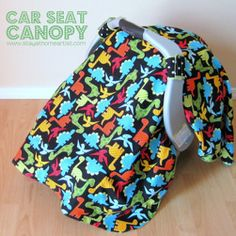 Dino-Riffic Car Seat Canopy - Parents of babies always want to give their child the best, but sometimes the best can be a bit costly. Check out this tutorial to learn how to sew a #DIY Dino-Riffic Car Seat Canopy, which is both easy and budget-friendly to create. A #homemade car seat canopy is exactly what you need to your baby a cozy place to sleep no matter where you go.