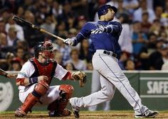 Tampa Bay Rays' Carlos Pena follows through on a 2-run home run as Boston Red Sox catcher Jarrod Saltalamacchia watches in the 5th inning of a baseball game at Fenway Park in Boston on Wednesday, September 26, 2012. (AP Photo/Elise Amendola)