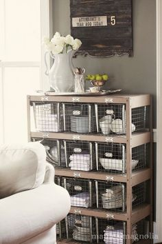 shelving case with wire baskets & pretty display on top