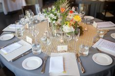 I like the fabric square as the center of the table for centerpieces. I could see us using them again