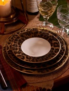 Getting multiple China and Dining sets now that I have a big lit up cabinet for it! Ralph Lauren Home. Leopard print anything is desirable!