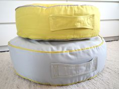 Floor Cushion Ottoman Pouf - Yellow or Grey Toddler Floor Cushions Pouf - Nursery Kidsroom Decor - Yoga Meditation Cushion - Home Decor  Made to order - Ready to ship in 3/4 weeks  This ottoman is wonderful for every room in your home. Made in cotton canvas with piping and a handle for easy lifting and carrying. This fabric has a anti stain treatement! Its very comfortable and stylish to your home decor!   Colors: -Yellow with grey piping - Light grey with yellow piping  The ottoman have...
