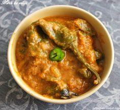 Mirch ka salan - Whole green chili or jalapeno stir fried and simmered in peanut and sesame sauce.