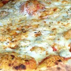 Four Cheese Pizza w/ Homemade Tomato Sauce..........Mozzarella Cheese, Blue Cheese, Goat Cheese & Parmesan Cheese
