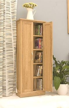 DVD Storage Cupboard Mobel Oak COR17BSuperb contemporary designThe cupboard is designed to provide storage for both CDs and DVDsHolds approximately 190 CDs or 125 DVDsCrafted from the highest grade, selected solid oakExceptional build qualityHardwood backNo veneersPanelled sidesTongue and groove backBrushed steel handlesResilient satin lacquer finishSupplied ready assembledPart of our Mobel Oak contemporary furniture rangeDetailsDimensions: H128.8 x W49 x D20.5 cm