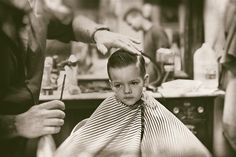 Grooming young men to be gentlemen! Youngster at the Barber Shop learning from Daddy & Grandpas. www.loganbros.com
