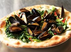 Yes, those are mussels on your #pizza. It's one of the many reasons #London is becoming the capital of #food.