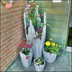 """Cement pots: Use water, cement and old towels/rags/tablecloths. Make a """"tea"""" of cement and water, soak cloth til heavy, drape over an upside down container/bucket, arrange as you please. Let cure. If needed coat with more cement to increase strength. Paint/stain as desired. drop potted flowers inside new holder."""