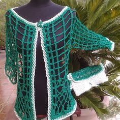 | Verde intreccio | cardigan interamente realizzato uncinetto con fettuccia di viscosa lucida, articolo unico, tg 44/46 cod 124