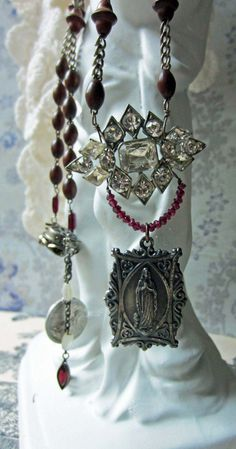 hail mary - vintage assemblage rosary necklace with virgin mary medal and rhinestones by the french circus. $94.00, via Etsy.