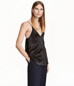 Black. V-neck camisole top with a sheen. Double layers of fabric over bust and narrow, adjustable shoulder straps.