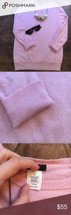 J crew cashmere and angora blend pullover Holy softness, Batman. This baby pink sweater with bracelet length sleeves is part angora, part cashmere, part merino (see last pictures for details). In great preworn condition. Got it as a present and wore it a few times, but the color washes me out. Size M J. Crew Sweaters Crew & Scoop Necks