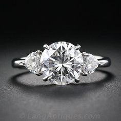 Sweet heart shaped side stones, 2.03 Carat Estate Platinum and Diamond Engagement Ring - 10-1-4626 - Lang Antiques