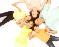 Fun on the floor for a family of five! Family Photography at The Picture Company  Photo taken by Crystal
